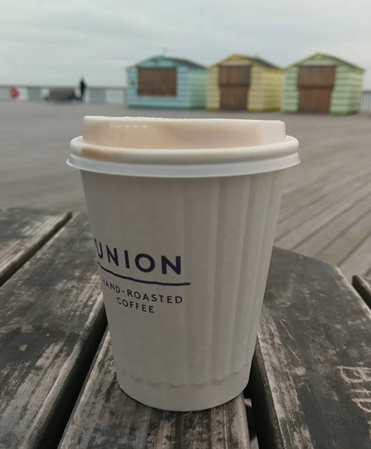 Hastings web design on the pier with a coffee